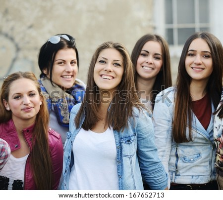 Happy teen girls having good fun time outdoors