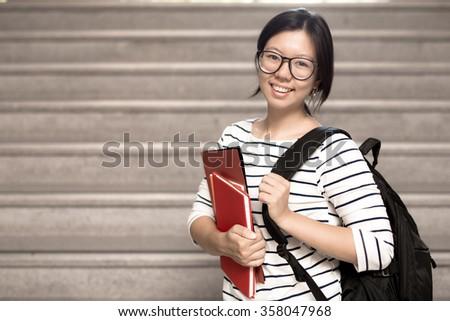 Happy teen high school student - stock photo