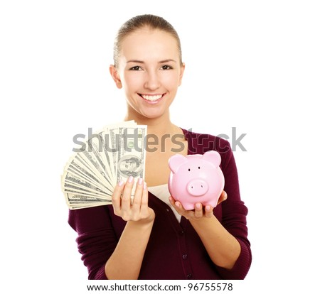 Happy teen holding a piggy bank and dollars , isolated on white background