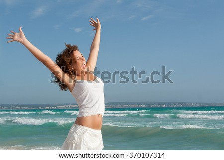 happy teen on summer or spring break holiday arms up - stock photo