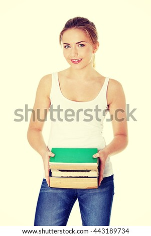 Happy teen woman holding books - stock photo