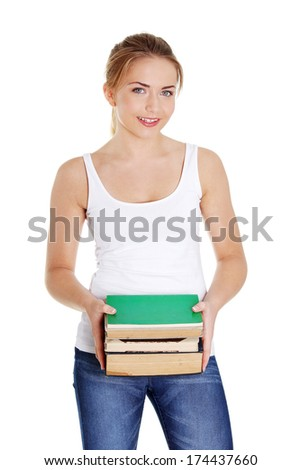 Happy teen woman holding books , isolated on white background