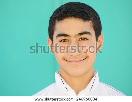 Happy teenage Arabic boy - stock photo