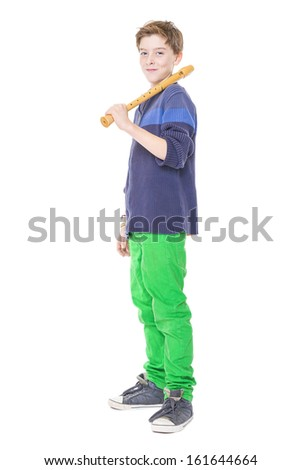 happy teenage boy holding a flute on his shoulder, isolated on white. - stock photo