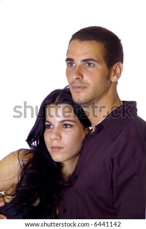 Happy teenage couple hugging isolated over white