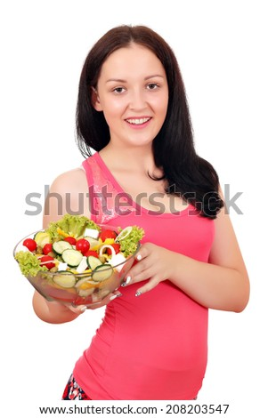 happy teenage girl holding dish with salad