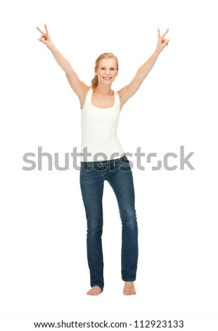 happy teenage girl in blank white t-shirt showing victory sign