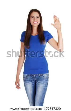 Happy teenage girl waving a greeting , isolated on white - stock photo