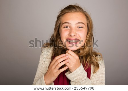 happy teenage girl wearing braces - stock photo
