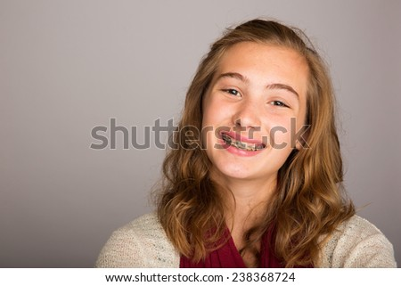happy teenage girl wearing braces