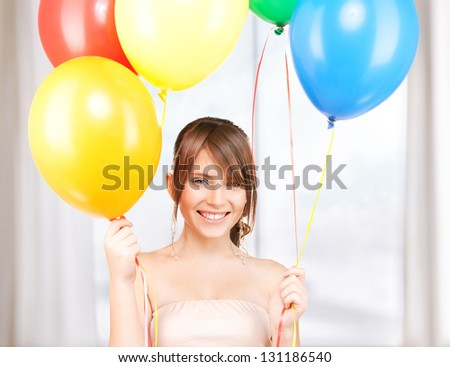 happy teenage girl with balloons at home party - stock photo