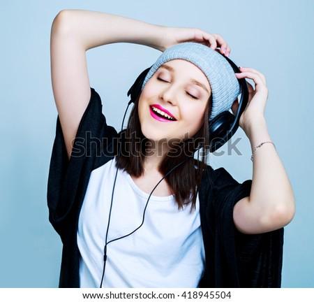 happy teenage girl with earphones listening to the music - stock photo