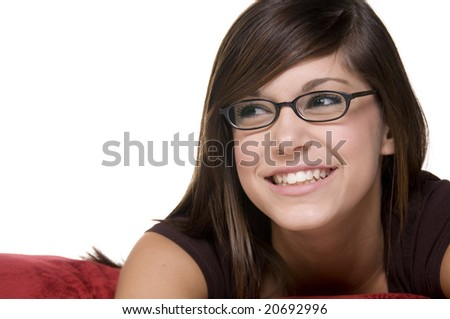 Happy teenage girl with glasses.