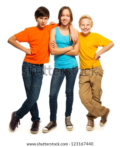 Happy teenage kids in casual everyday shirts smiling and standing isolated on white