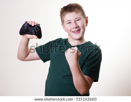 happy teenager (boy) handing gamepad after a hard game battle