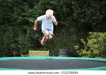 trampolines for teenagers happy kid plays outdoors garden jumping stock photo 361425299