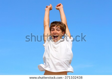 Happy Teenager jumping on the Blue Sky Background - stock photo