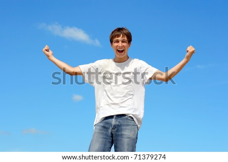 happy teenager on blue sky background - stock photo