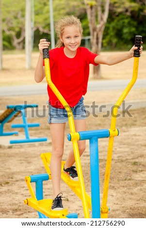 Happy teenager on the playground at the day time - stock photo