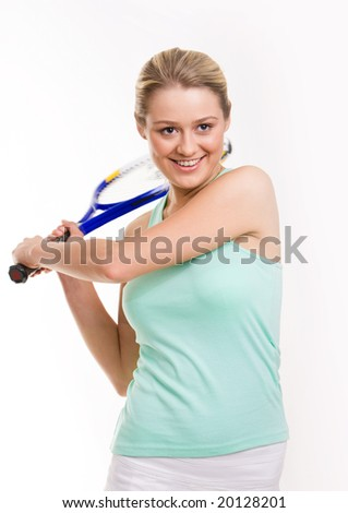 Happy teenager playing tennis with racquet in hands - stock photo