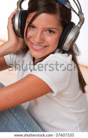 Happy teenager with headphones listening to music