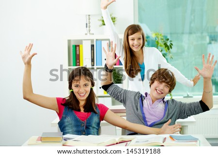 Happy teenagers enjoying themselves at school