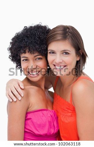 Happy teenagers putting hands on the shoulders of each other - stock photo