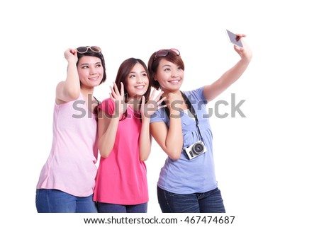 Happy teenagers woman taking pictures by themselves isolated on white background, asian