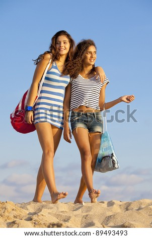 happy teens on beach vacation or spring break - stock photo