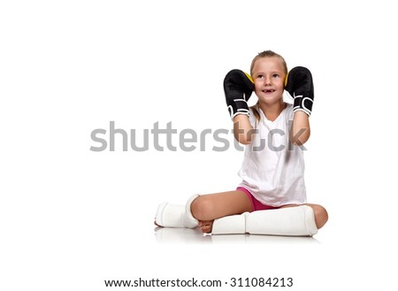 happy thai boxing girl sitting on floor