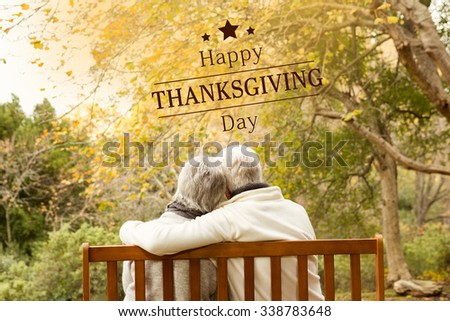 Happy thanksgiving against senior couple in the park - stock photo