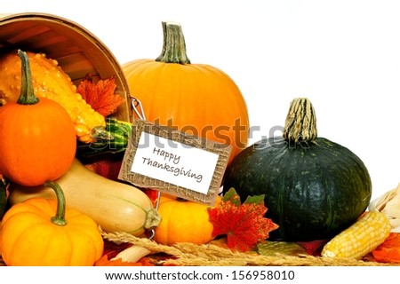 Happy Thanksgiving card with vegetables spilling from a harvest pail - stock photo