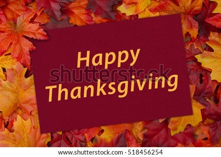 Happy Thanksgiving Greeting Card, Some fall leaves and a greeting card with text Happy Thanksgiving