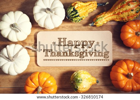 Happy Thanksgiving message with colorful pumpkins and squashes - stock photo