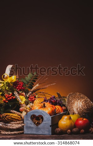 Happy Thanksgiving still life. Fruits, nuts and vegetables, fall crop on  the table. Copy space - stock photo