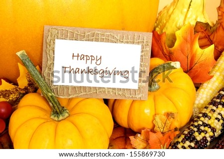 Happy Thanksgiving tag with pumpkins and autumn decor over white