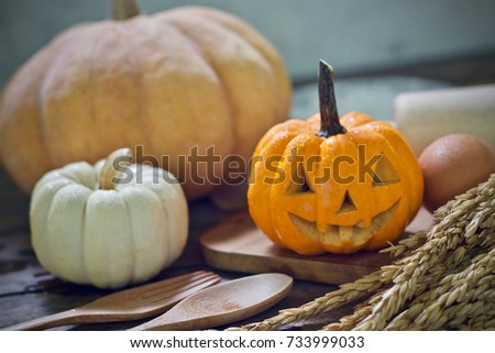 Happy Thanksgiving Wooden Blocks Against A Rustic Wood Background With Pumpkin And Autumn