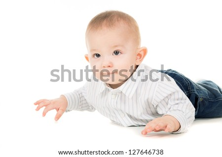 happy the child in clothes crawling on the floor isolated on white background