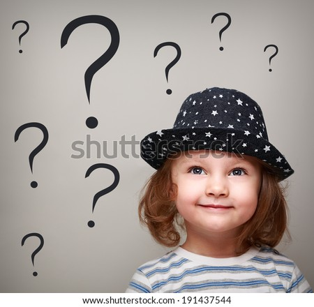 Happy thinking kid girl in hat looking up on many questions above the head - stock photo