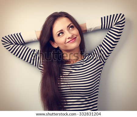Happy thinking young woman relaxing and looking up. Vintage closeup portrait - stock photo