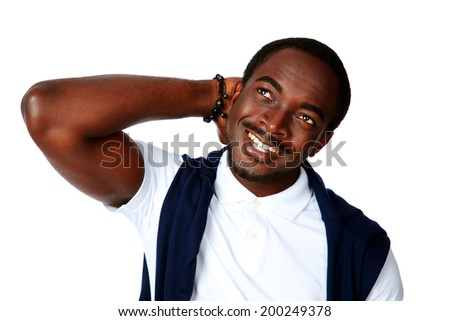 Happy thoughtful african man looking up over white background - stock photo