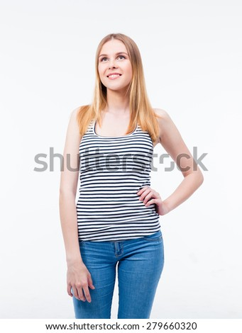 Happy thoughtful woman looking up at copyspace isolated on a white background - stock photo