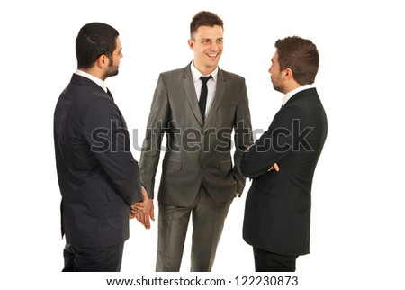 Happy three business men having conversation isolated on white background