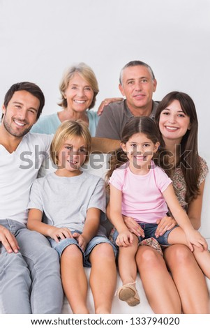Happy three generation family on the couch - stock photo