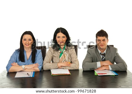 Happy three people sitting on chairs in a row and waiting for interview isolated on white background - stock photo