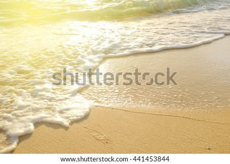 Happy time for recreation on sand of beach with sea wave cozy background - stock photo