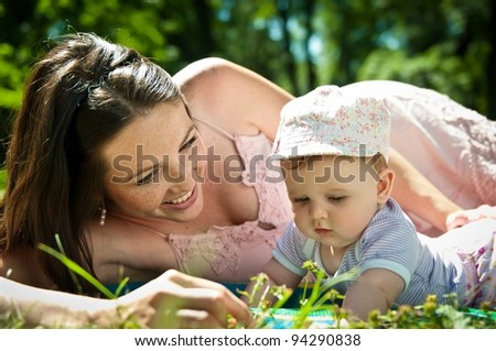 Happy time - mother with baby - stock photo