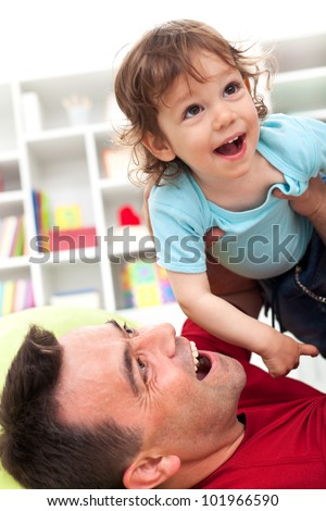 Happy times playing with dad - little boy enjoying playtime, shallow depth of field - stock photo