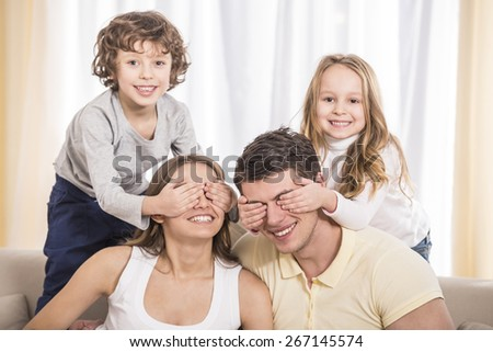Happy to be a family. Portrait of happy family with kids on the couch.