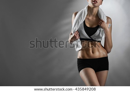 Happy to train. Cropped horizontal shot of a healthy fitness woman posing after her gym workout holding a towel copyspace on the side - stock photo